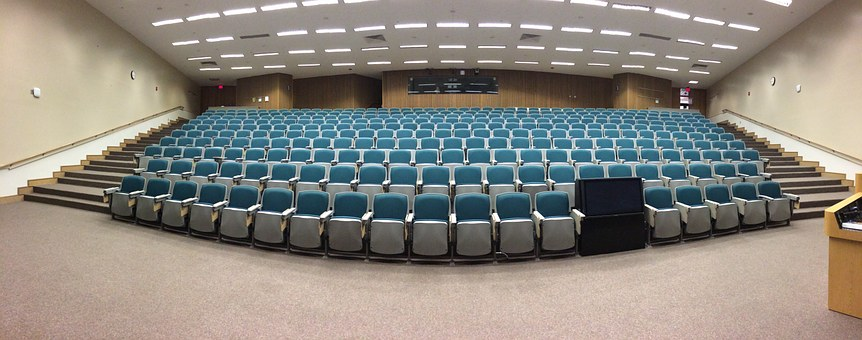 room for attending symposiums rows of chairs
