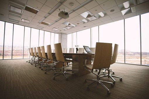 conference room for business meeting chairs and desk