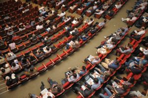 Birdseye view of all the people sitting in the audience at the QUIS Symposium