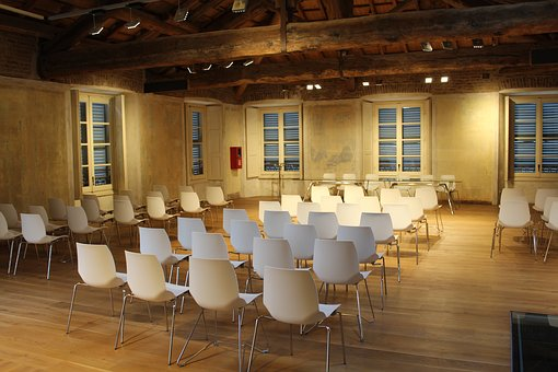 conferences to attend across the UK chairs set up in room